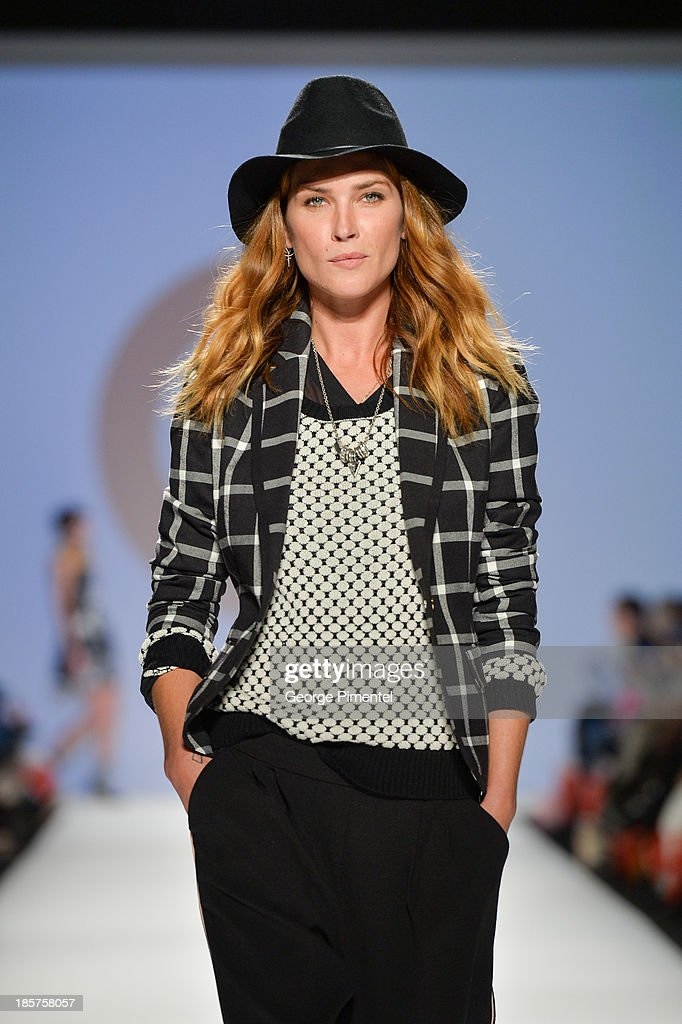 Model Erin Wasson walks the runway wearing Target spring 2014 collection during World MasterCard Fashion Week Spring 2014 at David Pecaut Square on October 24, 2013 in Toronto, Canada.