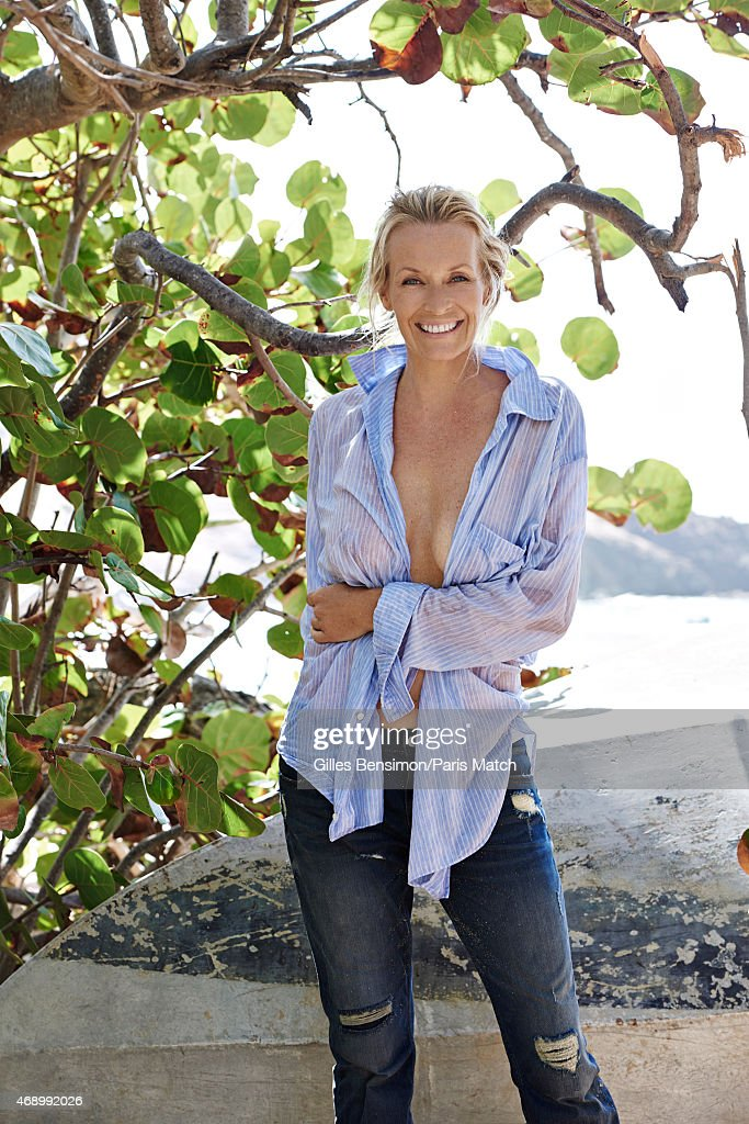 Model Estelle Lefebure is photographed for Paris Match on December 6, 2014 in Saint-Barthelemy ...