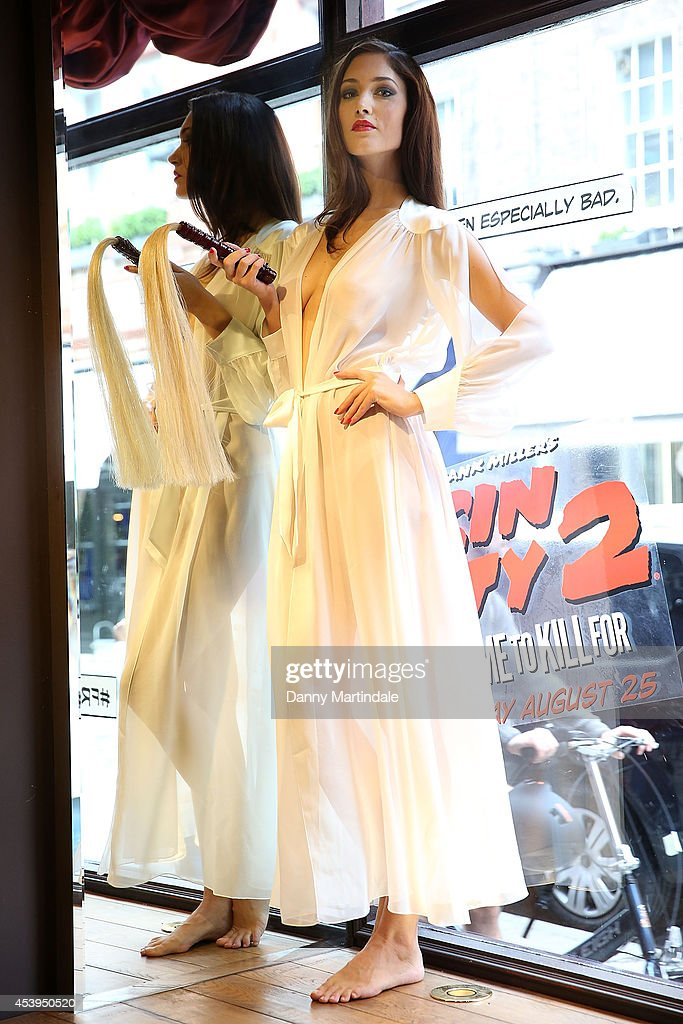 Model Eva Bohatova poses at a photocall recreation of the 'Sin City 2' movie poster at Coco De Mer on August 22, 2014 in London, England.