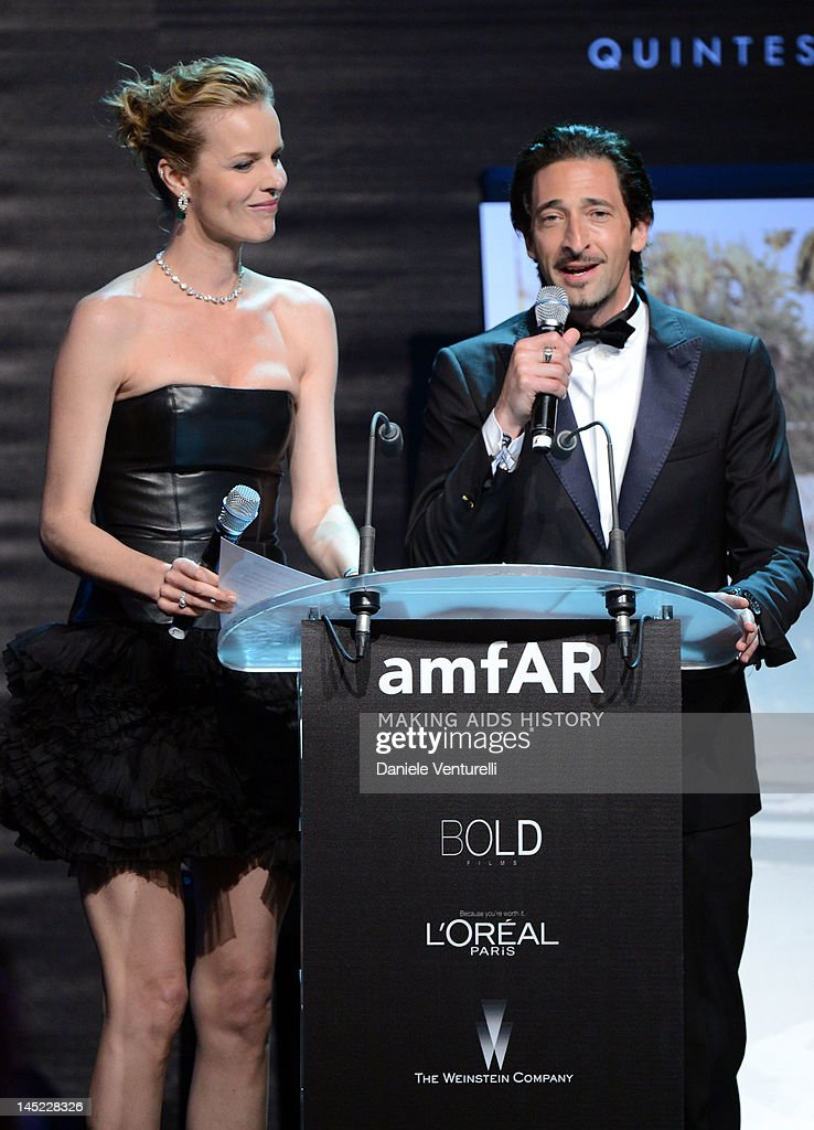 Model <a gi-track='captionPersonalityLinkClicked' href=/galleries/search?phrase=Eva+Herzigova&family=editorial&specificpeople=156428 ng-click='$event.stopPropagation()'>Eva Herzigova</a> and actor Adrien Brody speak at the 2012 amfAR's Cinema Against AIDS during the 65th Annual Cannes Film Festival at Hotel Du Cap on May 24, 2012 in Cap D'Antibes, France.