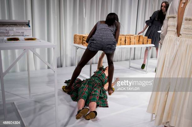 A model faints during British fashion designer Molly Goddard's show at the 2016 Spring / Summer Fashion Week in London on September 18 2015 AFP PHOTO...