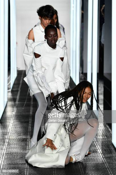A model falls on the runway during the StrateasCarlucci show at MercedesBenz Fashion Week Resort 18 Collections at Carriageworks on May 18 2017 in...