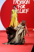 A model falls while walking down the runway at the Fashion For Relief at Forville market during the 64th Annual Cannes Film Festival on May 16 2011...
