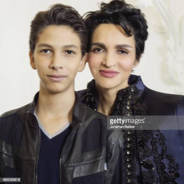 Model Farida Khelfa is photographed with son Omer for Town Country Magazine on July 5 2013 in Paris France PUBLISHED IMAGE