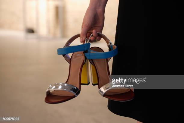 A model fashion detail poses prior to the Hugo Boss presentation during 'Der Berliner Mode Salon' Spring/Summer 2018 at St Agnes Church on July 6...