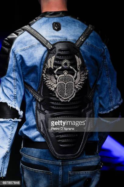 A model fashion detail walks the runway at the Frankie Morello show during Milan Men's Fashion Week Spring/Summer 2018 on June 19 2017 in Milan Italy