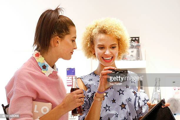 Model Fata Hasanovic and model Taynara Wolf attend the Iphoria store opening on December 6 2016 in Berlin Germany