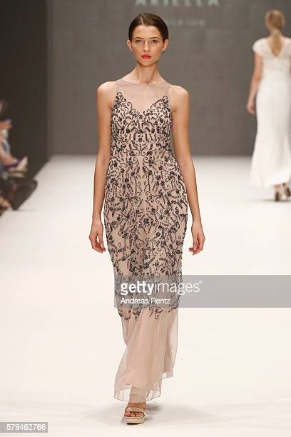 Model Fata Hasanovic walks the runway for Ariella as part of the Gallery show during Platform Fashion July 2016 at Areal Boehler on July 24 2016 in...