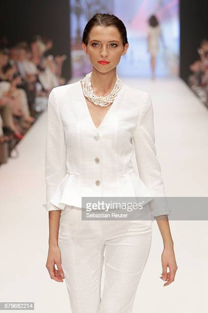 Model Fata Hasanovic walks the runway the Thomas Rath show during Platform Fashion July 2016 at Areal Boehler on July 24 2016 in Duesseldorf Germany