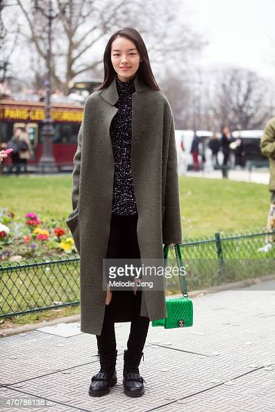 Model Fei Fei Sun exits the Chanel show with a Chanel bag at Grand Palais on Day 8 of Paris Fashion Week FW15 on March 10 2015 in Paris France