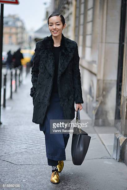 Model Fei Fei Sun leaves after the Dries Van Noten show during Paris Fashion Week FW16/17 on March 2 2016 in Paris France
