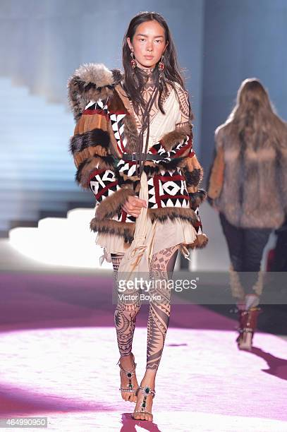 Model Fei Fei Sun walks the runway at the Dsquared2 show during the Milan Fashion Week Autumn/Winter 2015 on March 2 2015 in Milan Italy