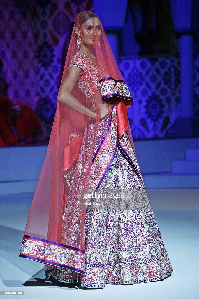 A model flaunts Suneet Varma's creation in New Delhi on Saturday.