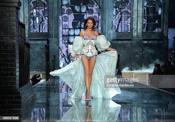 Model Flavia Lucini from Brazil walks the runway during the 2015 Victoria's Secret Fashion Show at Lexington Avenue Armory on November 10 2015 in New...