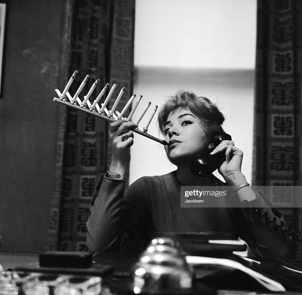 Model Frances Richards smokes a pack of cigarettes all on one cigarette holder.