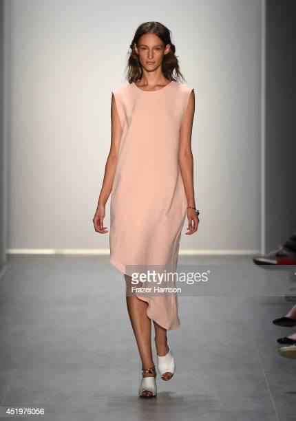Model Franzi Mueller walks the runway at the Malaikaraiss show during the MercedesBenz Fashion Week Spring/Summer 2015 at Erika Hess Eisstadion on...