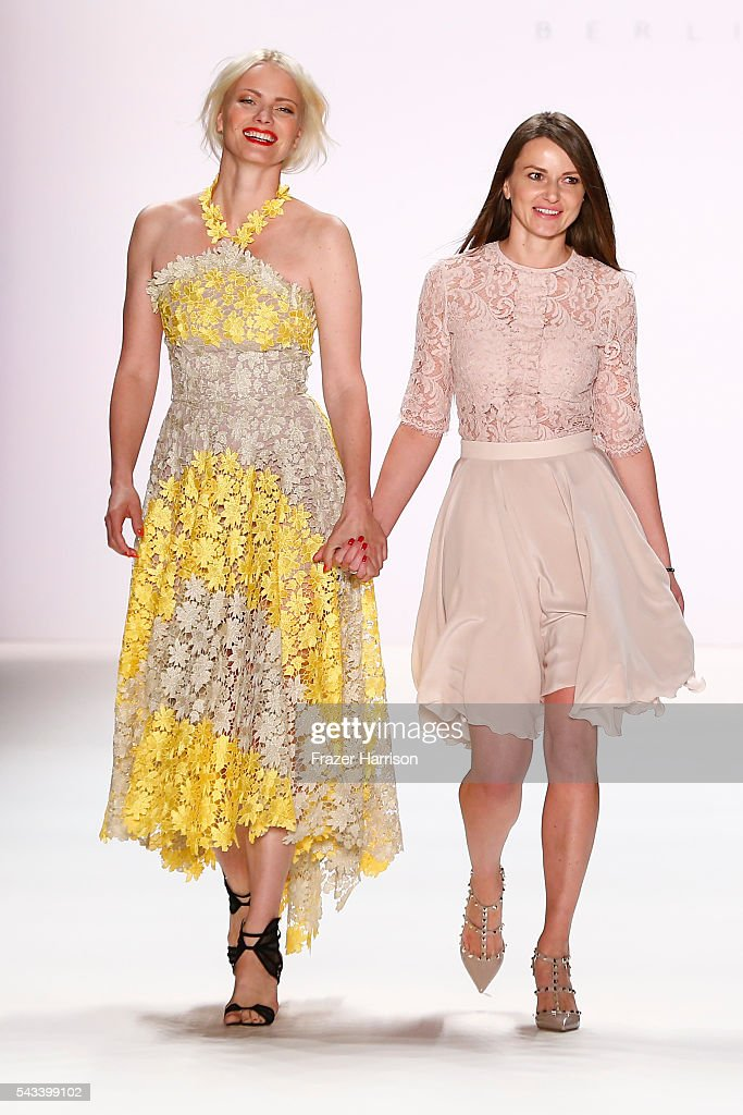 Model Franziska Knuppe and deisgner Ewa Herzog acknowledge the applause of the audience at the Ewa Herzog show during the Mercedes-Benz Fashion Week Berlin Spring/Summer 2017 at Erika Hess Eisstadion on June 28, 2016 in Berlin, Germany.