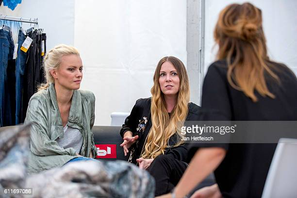 Model Franziska Knuppe and designer Rebekka Ruetz are seen backstage ahead of the Rebekka Ruetz Fashion Show during the 'innsbruck at night' show on...
