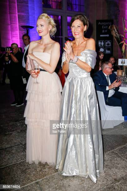 Model Franziska Knuppe and Minx Designer Eva Lutz during the Minx Fashion Night in favour of 'Sauti Kuu' of Auma Obama at Wuerzburger Residenz on...