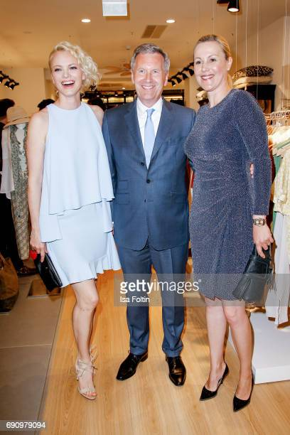 Model Franziska Knuppe former German president Christian Wulff and his wife and former first Lady Bettina Wulff attend the Yargici Flagship Store...
