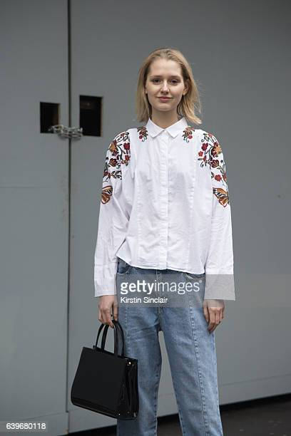 Model Freyja Refoy wears an Alice bag and Zara shirt and jeans day 2 of London Mens Fashion Week Autumn/Winter 2017 on January 07 2017 in London...