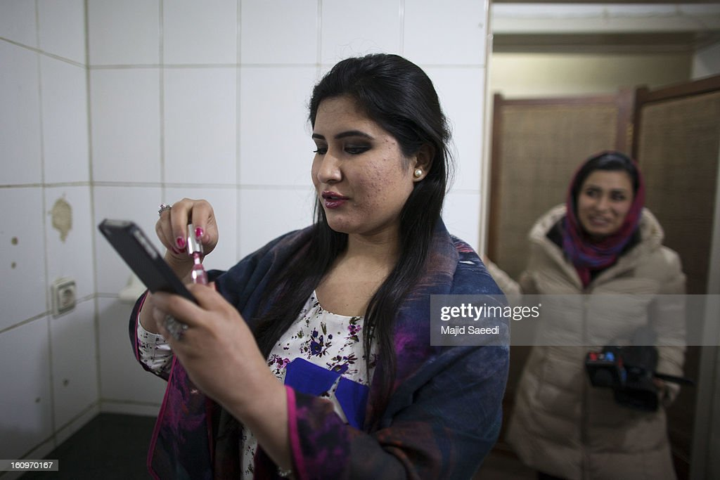 A model from 'Young Women For Change' applies make-up as she prepares to showcase designs by Afghan designer, Shahr Banu Zeera, during her fashion show on February 8, 2013 in Kabul, Afghanistan. Last year 'Young Women For Change' opened a women's only internet cafe with money raised online, naming it after 14-year-old Sahar Gul, the victim of severe abuse at the hands of her family whose suffering made international headlines. This is Zeerak's first fashion show in the city.