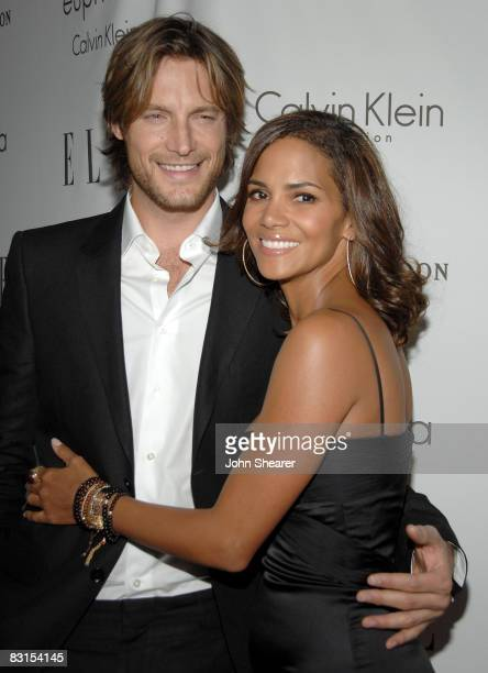 Model Gabriel Aubry and actress Halle Berry arrive to ELLE Magazine's 15th Annual Women in Hollywood Tribute held at The Four Seasons on October 6...