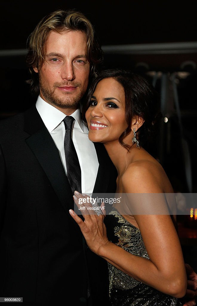 Model <a gi-track='captionPersonalityLinkClicked' href=/galleries/search?phrase=Gabriel+Aubry&family=editorial&specificpeople=467561 ng-click='$event.stopPropagation()'>Gabriel Aubry</a> and actress <a gi-track='captionPersonalityLinkClicked' href=/galleries/search?phrase=Halle+Berry&family=editorial&specificpeople=201726 ng-click='$event.stopPropagation()'>Halle Berry</a> attend the 2009 Vanity Fair Oscar party hosted by Graydon Carter at the Sunset Tower Hotel on February 22, 2009 in West Hollywood, California.
