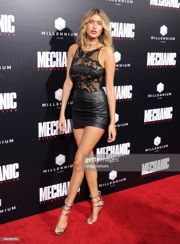 Model Gemma Vence arrives at the premiere of Summit Entertainment's 'Mechanic Resurrection' at ArcLight Hollywood on August 22 2016 in Hollywood...