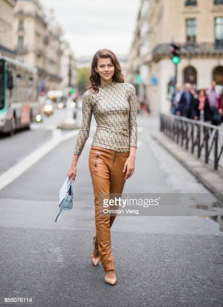 Model Georgia Fowler wearing brown pants is seen outside Balmain during Paris Fashion Week Spring/Summer 2018 on September 28 2017 in Paris France