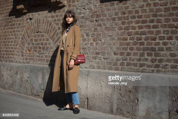 Model Georgia Fowler wears a camel coat red Chanel bag and Gucci shoes during Milan Fashion Week Fall/Winter 2017/18 on February 26 2017 in Milan...
