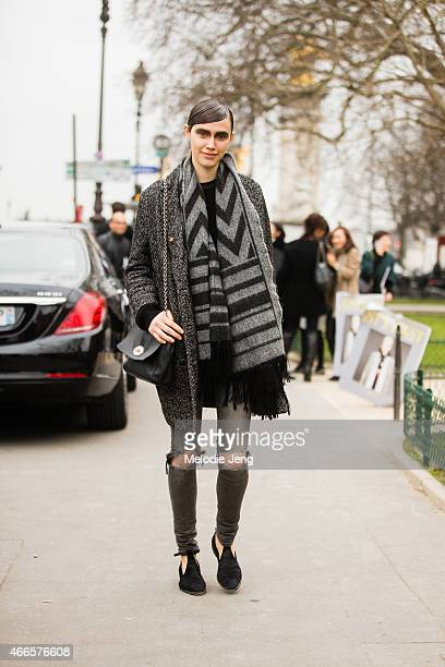 Model Georgia Hilmer exits the Chanel show at Grand Palais in a Mulberry bag on March 10 2015 in Paris France
