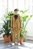 Model Geron McKinley poses at the Carlos Campos Spring/Summer 2016 Presentation during New York Fashion Week Men's S/S 2016 at Industria Superstudio...