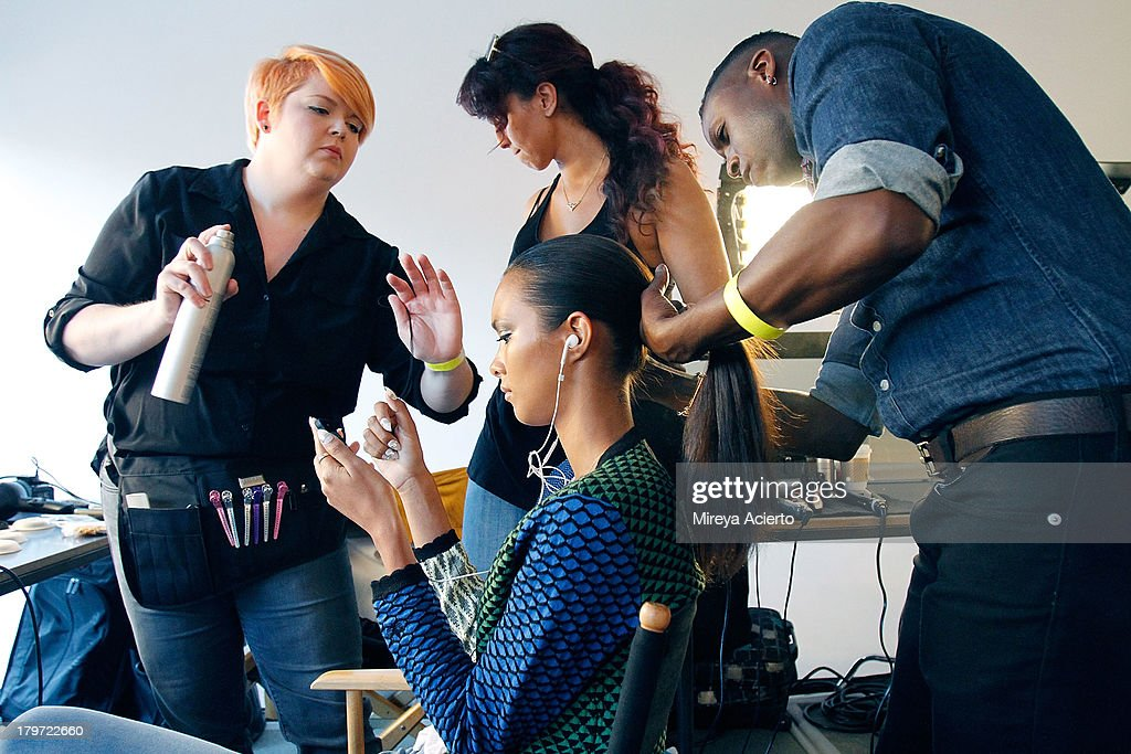 A model gets hair done backstage at the Cushnie Et Ochs fashion show during MADE Fashion Week Spring 2014 at Milk Studios on September 6, 2013 in New York City.