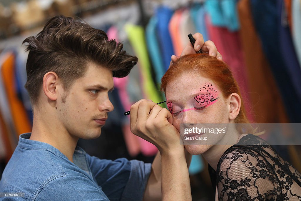 A model gets her face painted at the VSCT stand at the 2012 Bread & Butter fashion trade fair at former Tempelhof Airport on July 6, 2012 in Berlin, Germany. Bread & Butter is the world's largest trade fair for street fashion.