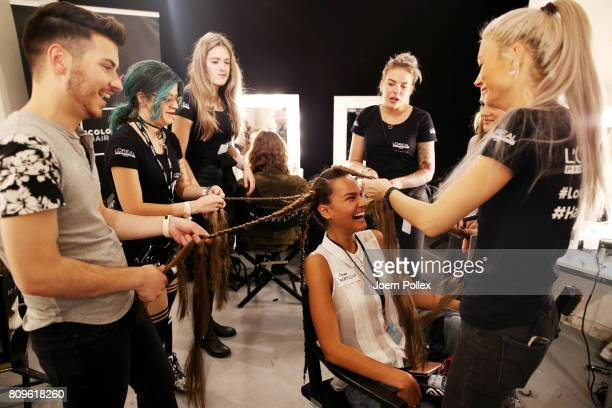 A model gets her hair done backstage ahead of the 'Designer for Tomorrow' show during the MercedesBenz Fashion Week Berlin Spring/Summer 2018 at...