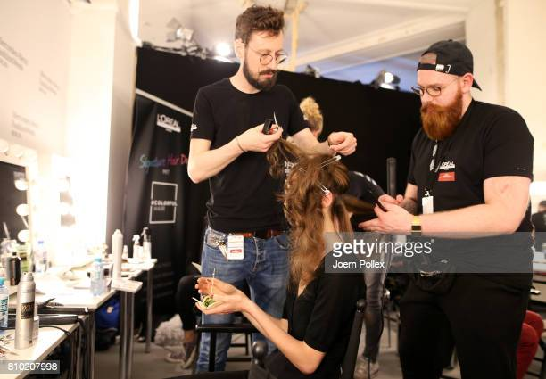 A model gets her hair done backstage ahead of the Franziska Michael show during the MercedesBenz Fashion Week Berlin Spring/Summer 2018 at Kaufhaus...