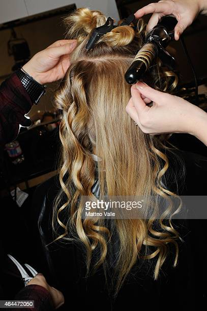 A model gets her hair done backstage ahead of the Max Mara show during the Milan Fashion Week Autumn/Winter 2015 on February 26 2015 in Milan Italy