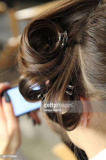 A model gets her hair done backstage at the Cushnie Et Ochs fashion show during MADE Fashion Week Fall 2014 at Milk Studios on February 7 2014 in New...