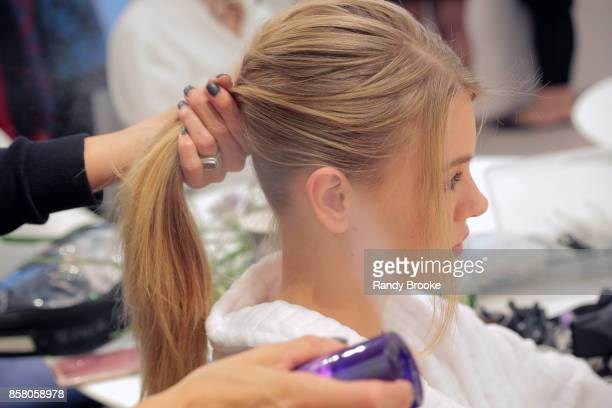 A model gets her hair done backstage at the Theia Bridal Show during New York Fashion Week Bridal October 2017 at Theia Showroom on October 5 2017 in...