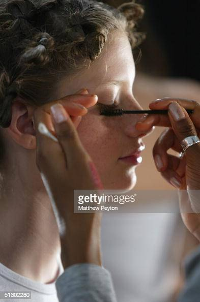 A model gets her makeup done backstage at the Rebecca Taylor Couture Spring 2005 fashion show during the Olympus Fashion Week Spring 2005 at the...