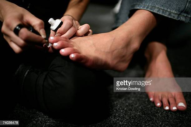 A model gets her toes painted before the Zambesi show backstage on day two of Rosemount Australian Fashion Week Spring/Summer 2007/08 in the Cargo...