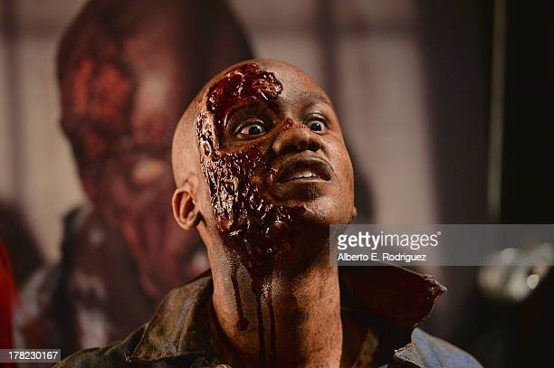 A model gets made up as a zombie at Universal Studios' 'Halloween Horror Nights' media makeup kickoff at The Globe Theatre on August 27 2013 in...