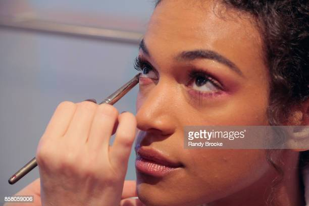 A model gets make up applied backstage at the Theia Bridal Show during New York Fashion Week Bridal October 2017 at Theia Showroom on October 5 2017...