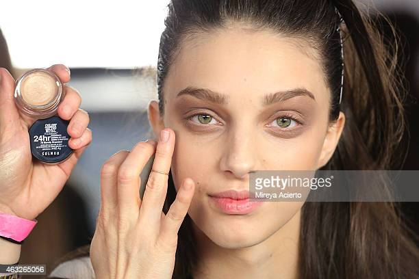 A model gets makeup applied backstage at Jonathan Simkhai presentation during MADE Fashion Week Fall 2015 at Milk Studios on February 12 2015 in New...