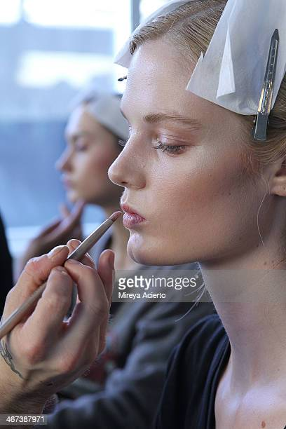 A model gets makeup applied backstage at the Costello Tagliapietra fashion show during MADE Fashion Week Fall 2014 at Milk Studios on February 6 2014...