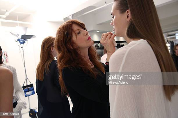 A model gets makeup applied backstage at the Organic By John Patrick runway show during MercedesBenz Fashion Week Spring 2015 on September 10 2014 in...