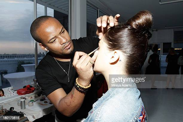 A model gets makeup backstage at the K Nicole fashion show during MercedesBenz Fashion Week Spring 2014 at The Designer's Loft at Studio 450 on...