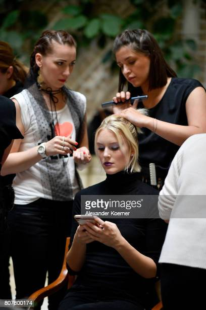 A model gets prepared backstage ahead of the Anja Gockel show during the MercedesBenz Fashion Week Berlin Spring/Summer 2018 at Hotel Adlon on July 4...