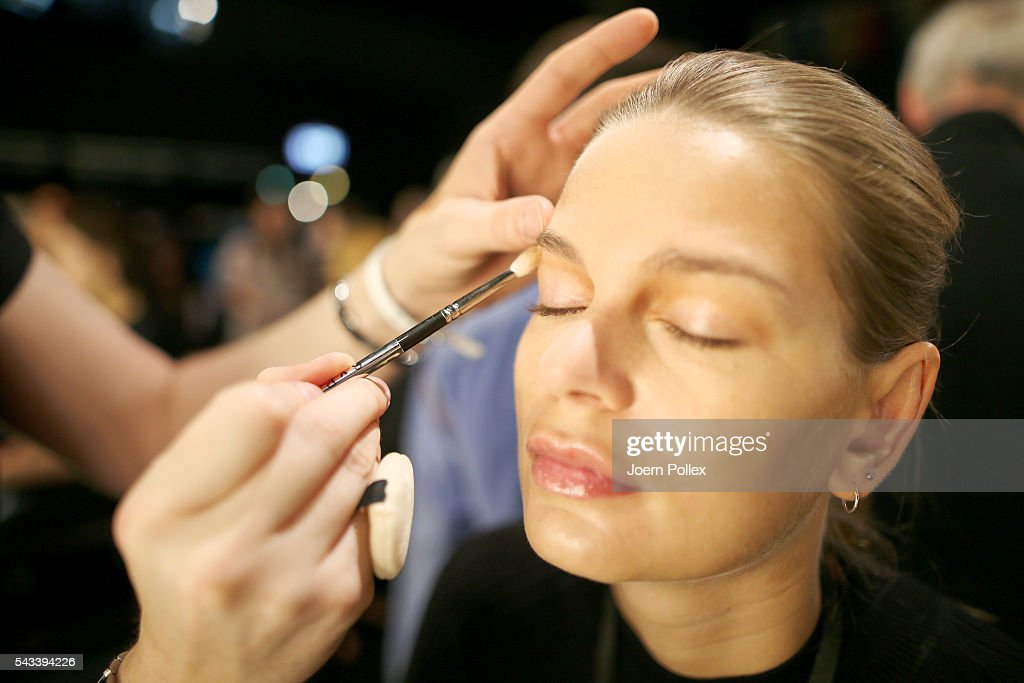A model gets prepared backstage ahead of the Ewa Herzog show during the Mercedes-Benz Fashion Week Berlin Spring/Summer 2017 at Erika Hess Eisstadion on June 28, 2016 in Berlin, Germany.
